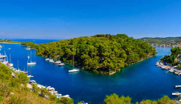 The beautiful island of Paxos, Greece. Panoramic view of the grand canal and old harbour.